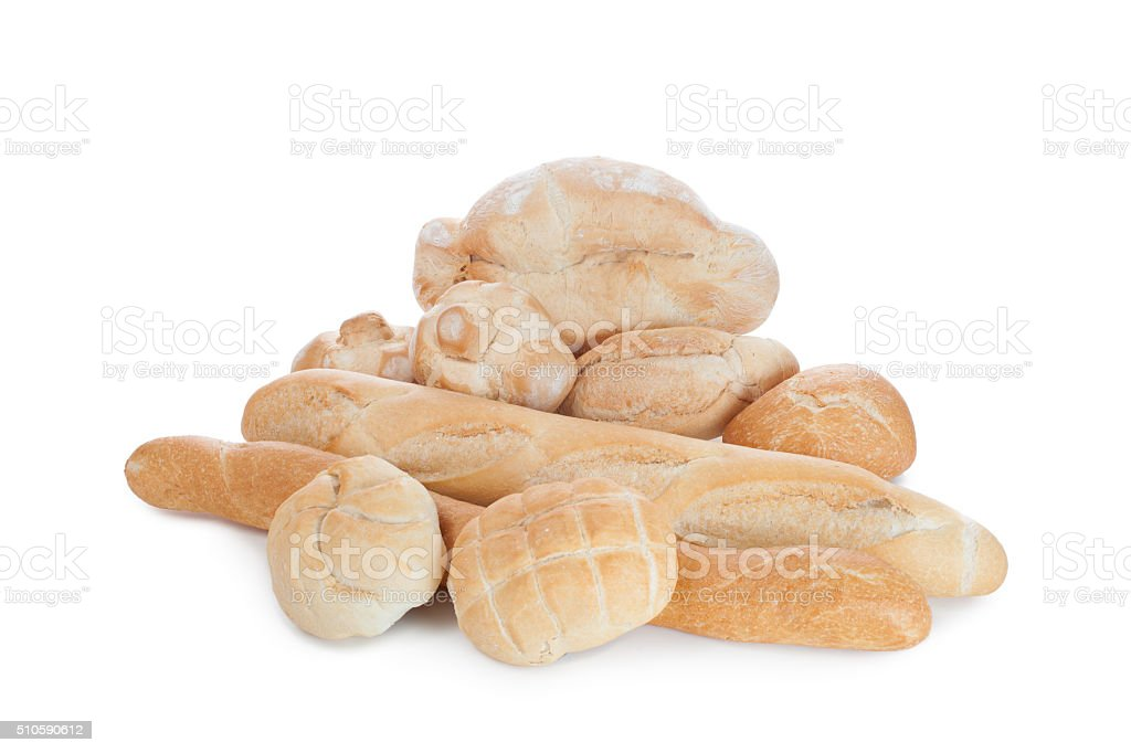 Gruppo di pani bianchi su di uno sfondo bianco stock photo