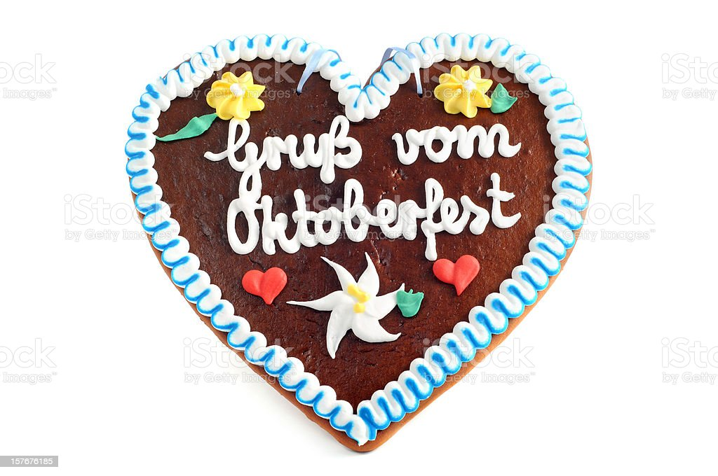 Gruss vom Oktoberfest Gingerbread Cookie in heart shape stock photo