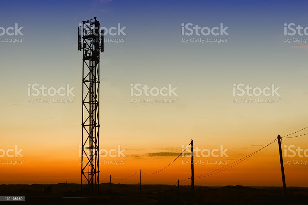 gsm tower and telephones pylons silhouettes royalty-free stock photo