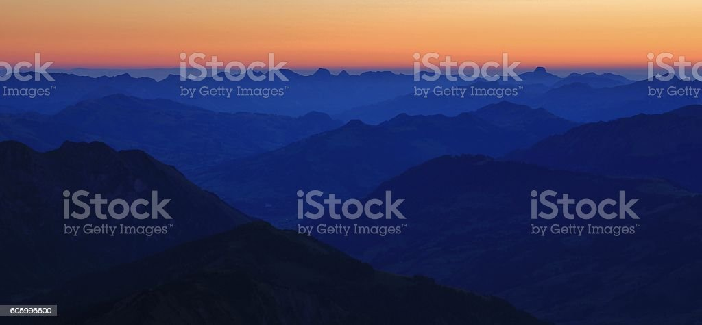 Gstaad and surrounding mountains at dawn stock photo
