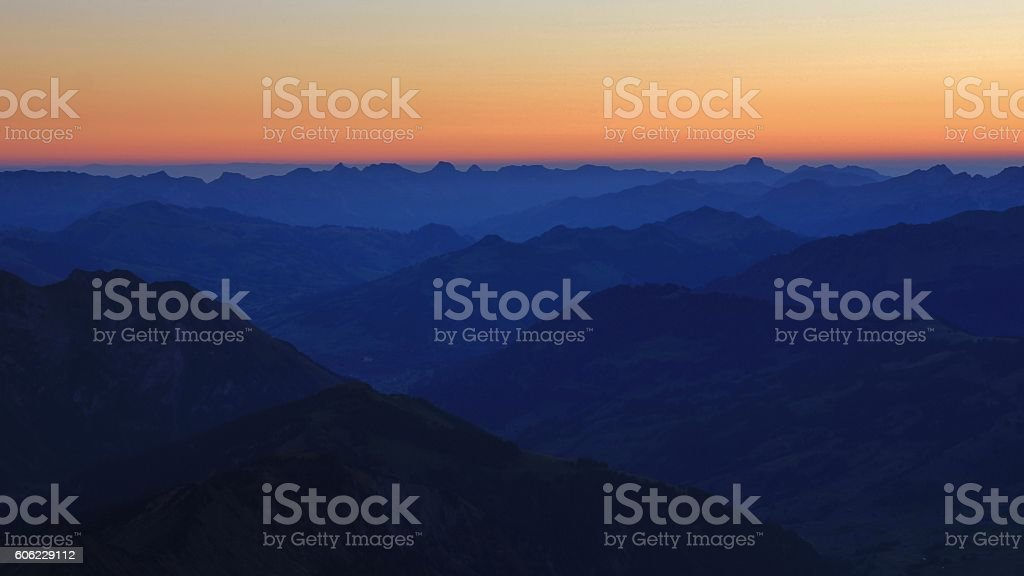 Gstaad and surrounding mountains before sunrise stock photo