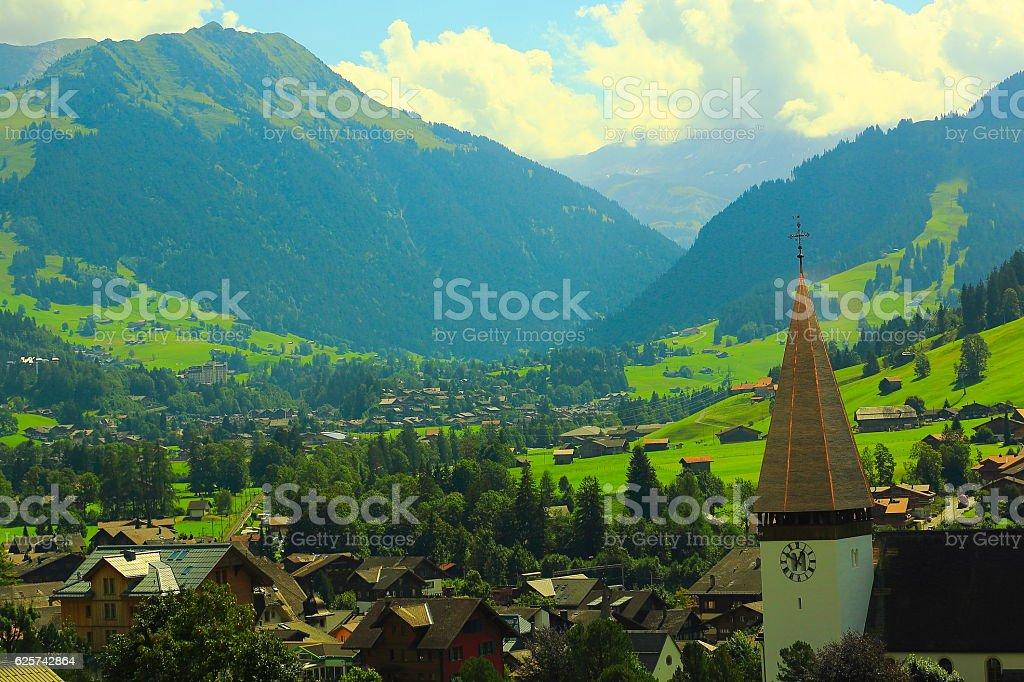 Gstaad idyllic alpine village panorama, Bern Canton, Swiss Alps stock photo