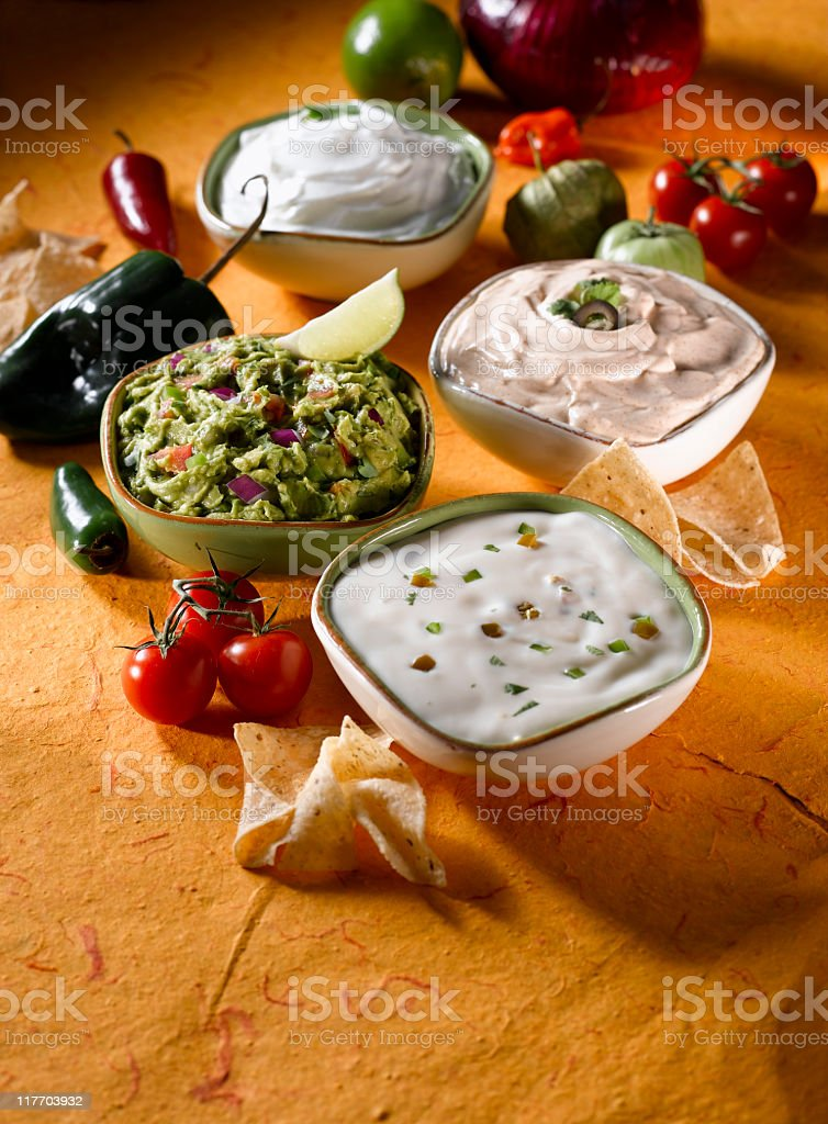 Guacamole and Mexican Cheese Dips stock photo
