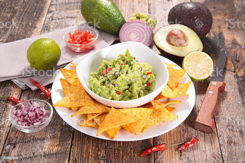 guacamole and tortilla chip stock photo