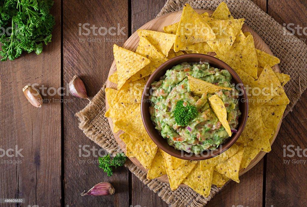 Guacamole avocado, lime, tomato, onion and cilantro, served with nachos stock photo