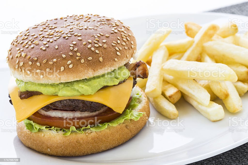 Guacamole burger and fries stock photo