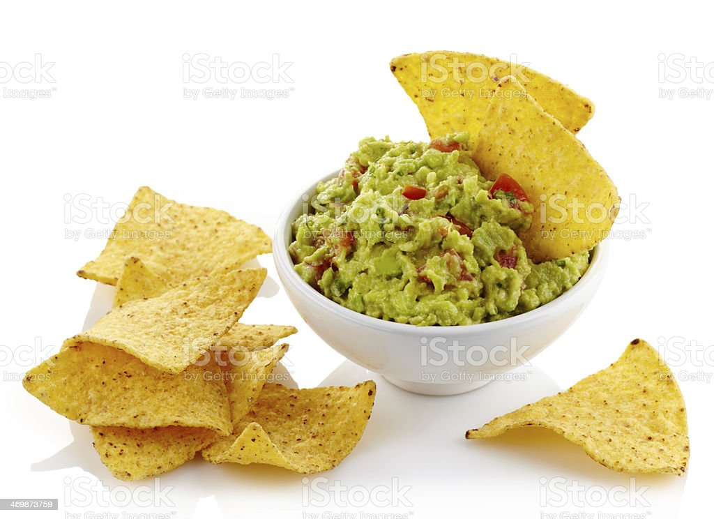Guacamole in a bowl and tortilla chips stock photo