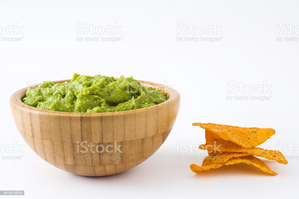 Guacamole in a wooden bowl stock photo