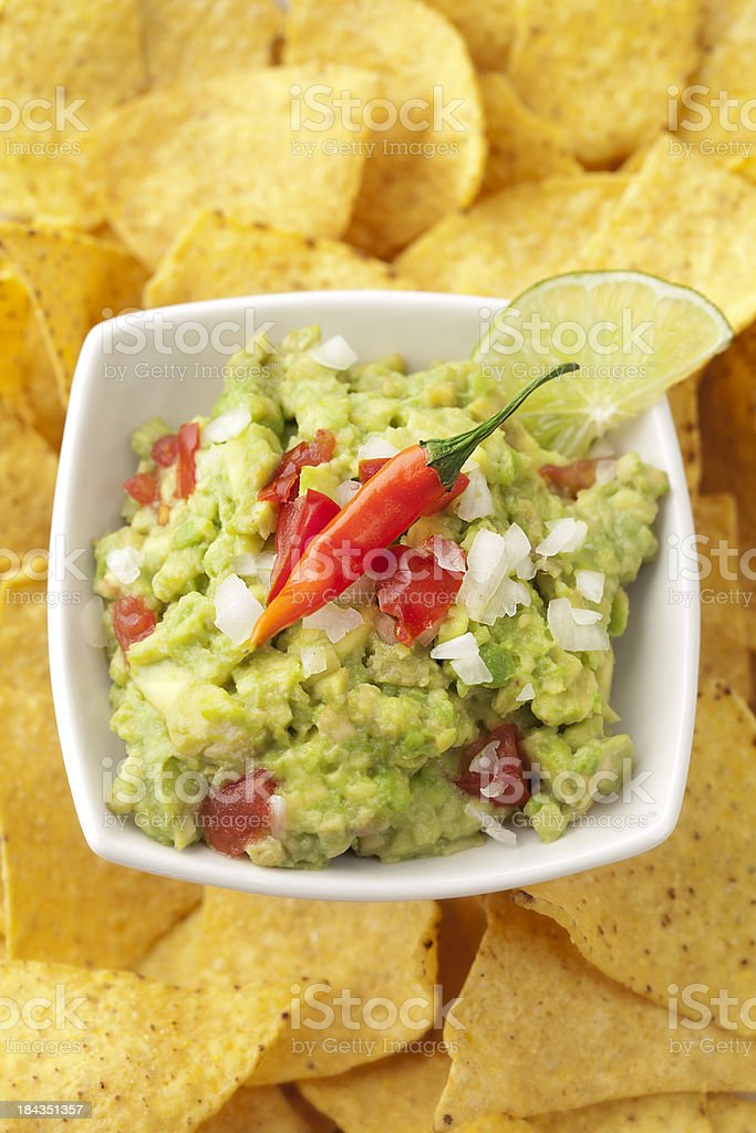 Guacamole with tortilla chips royalty-free stock photo