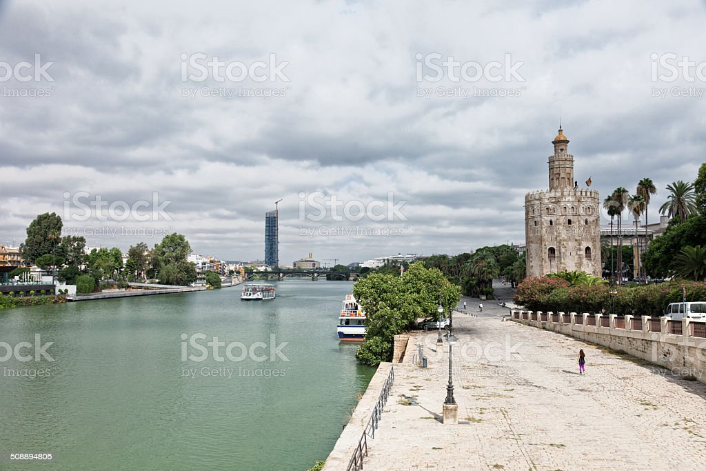 Guadalquivir River Embankment and Gold tower in Seville, Spain stock photo