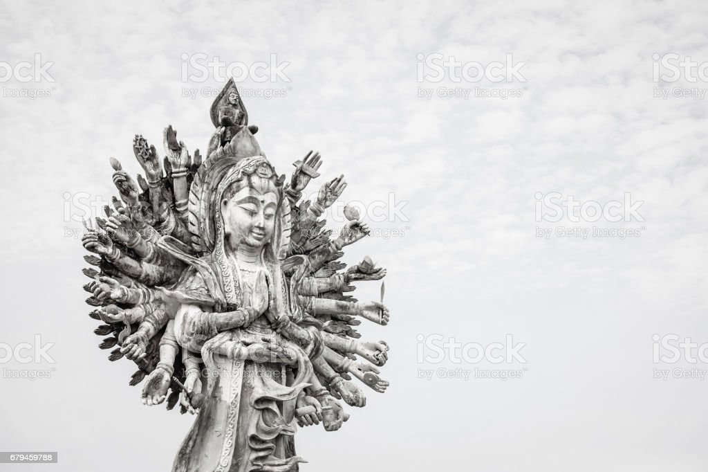 Guan Yin statue on sky background stock photo
