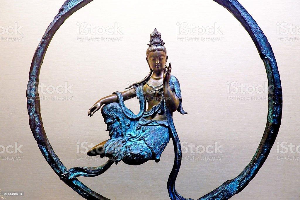 Guan Yin tin statue stock photo
