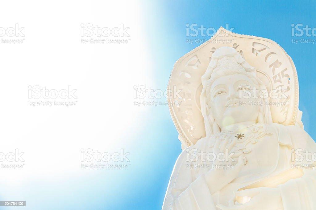 Guan Yin under blue sky bright sunlight stock photo