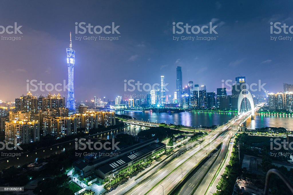 Guangzhou skyline at night on the Pearl River stock photo