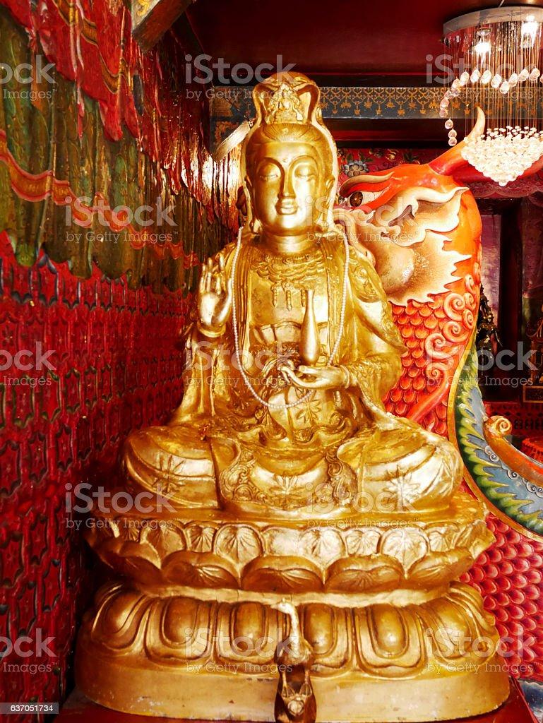 Guanyin bodhisattva statue in Chinese shrine stock photo