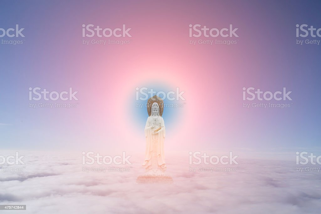 Guanyin sculpture in cloud,symbol of buddism stock photo