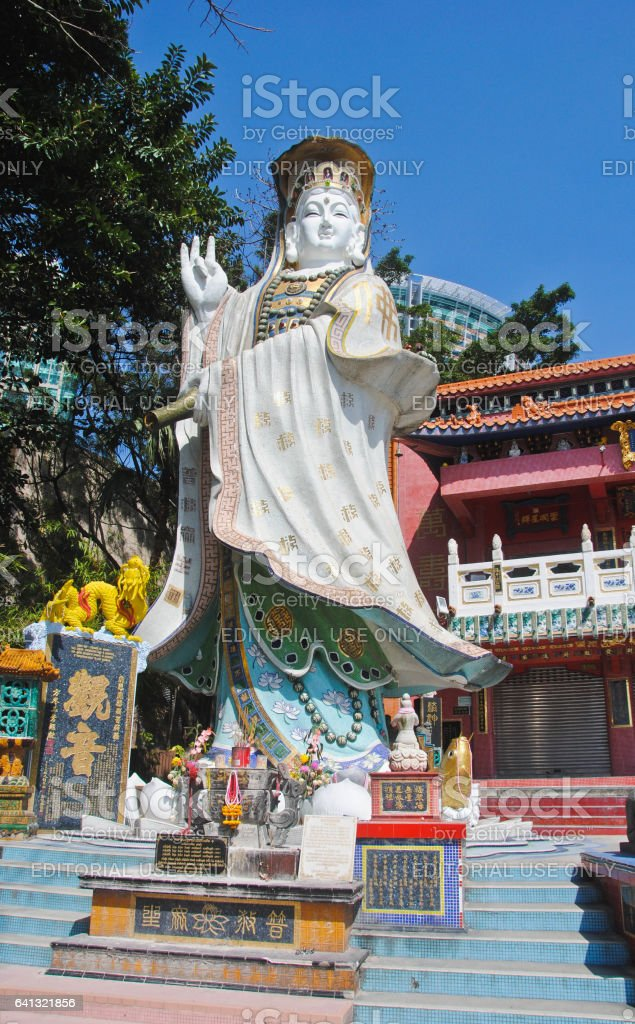 REPULSE BAY, HONG KONG – MARCH 02, 2016: Guanyin Statue locate in the Shrine at the end of the Repulse bay beach Hong Kong. MARCH 02, 2016 stock photo