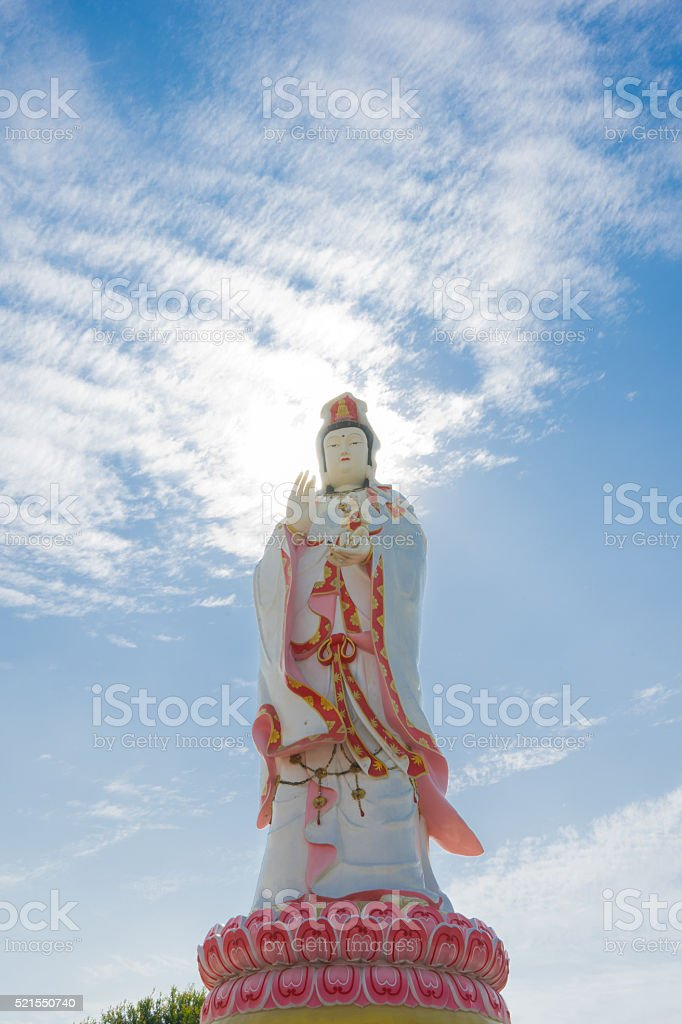 Guanyin Under blue skies stock photo