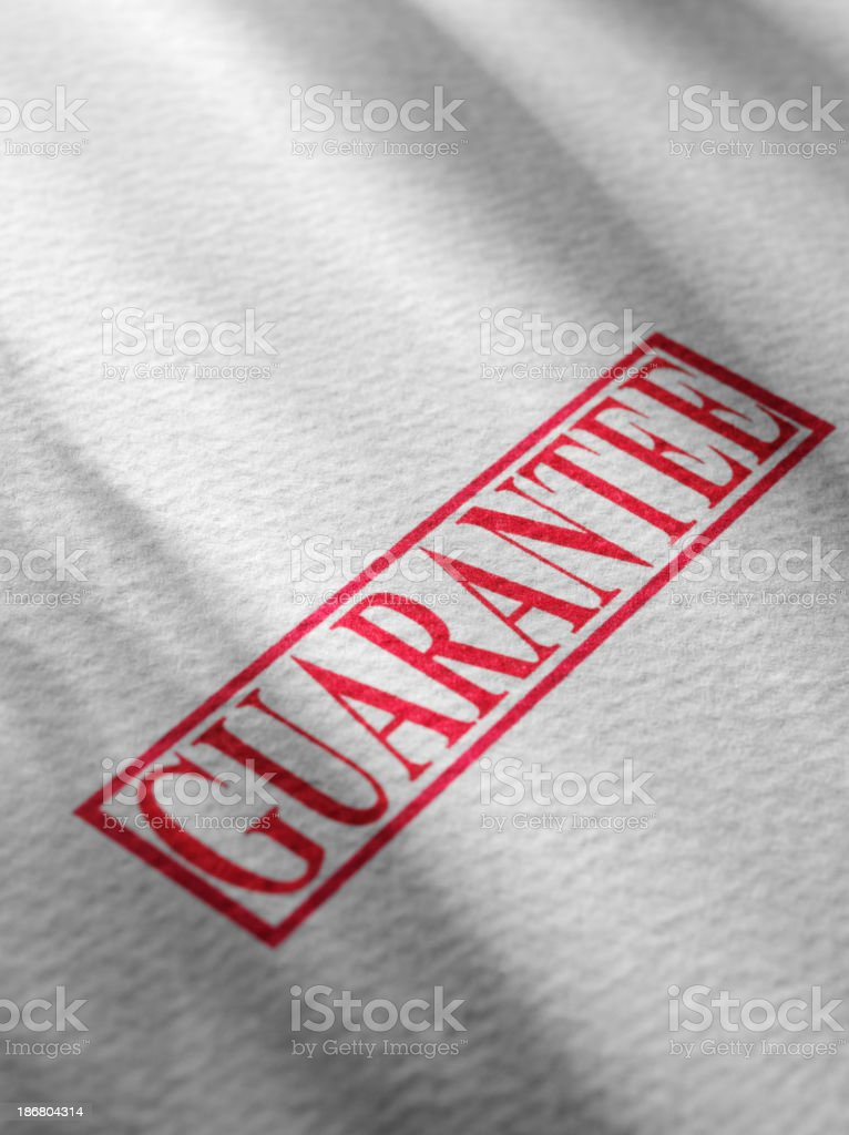 Guarantee Stamped on White Paper stock photo