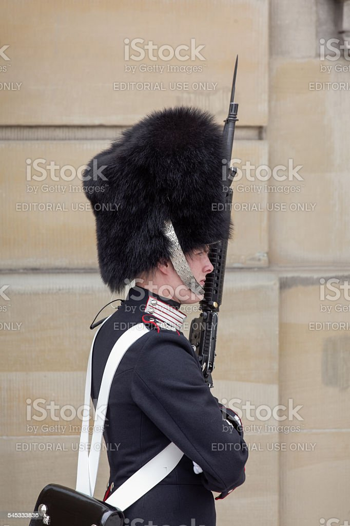 Guard at Amalienborg Palace Copenhagen Denmark stock photo