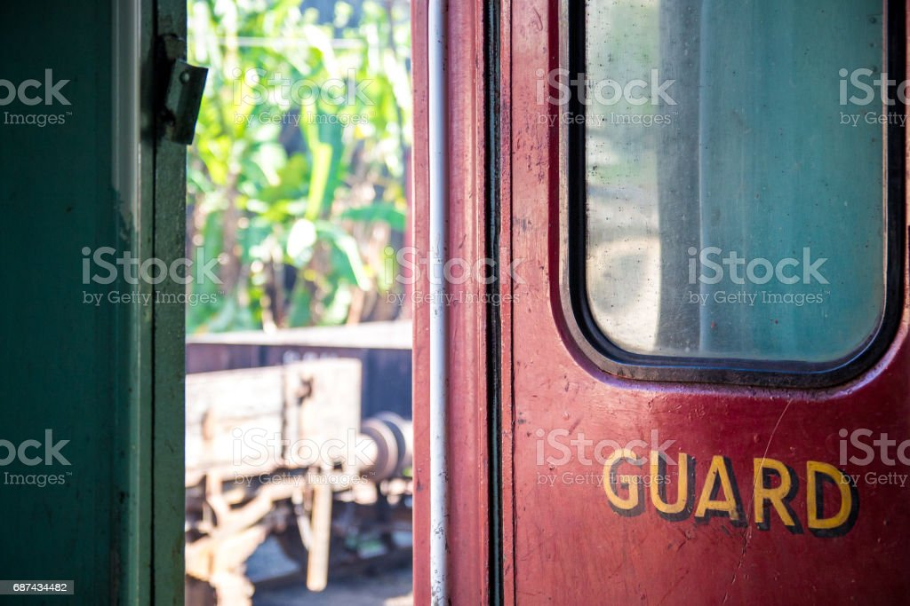 'Guard' door compartment of a train sitting idle in Kandy station, Sri Lanka. stock photo