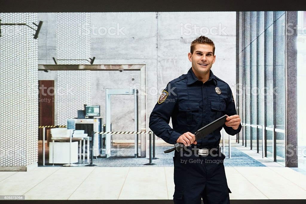 Guard holding a security wand stock photo