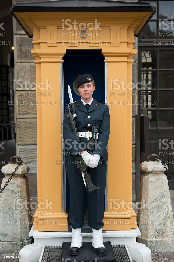 Guard outside Swedish Royal Palace in Stockholm stock photo