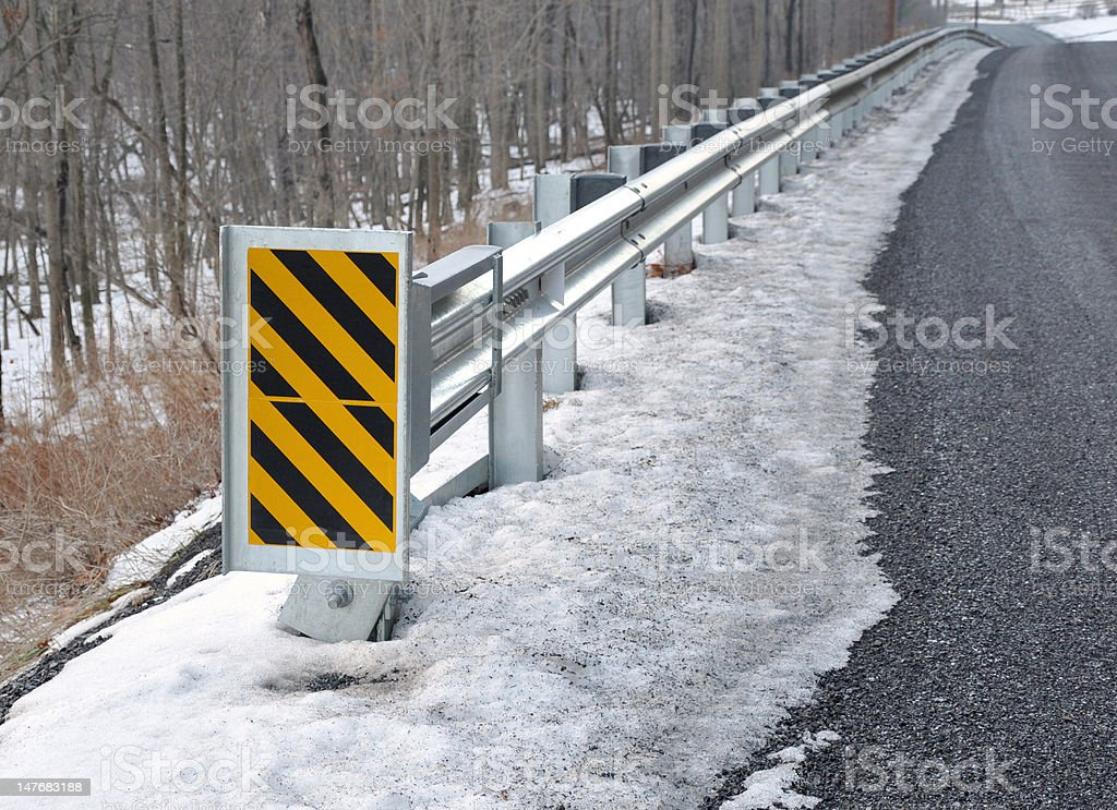Guard rail with warning sign royalty-free stock photo