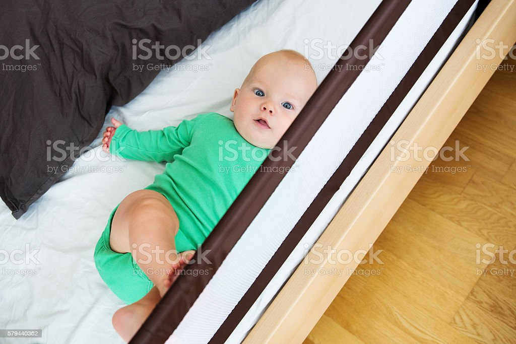 Guard rails for baby child bed. Baby child safety stock photo