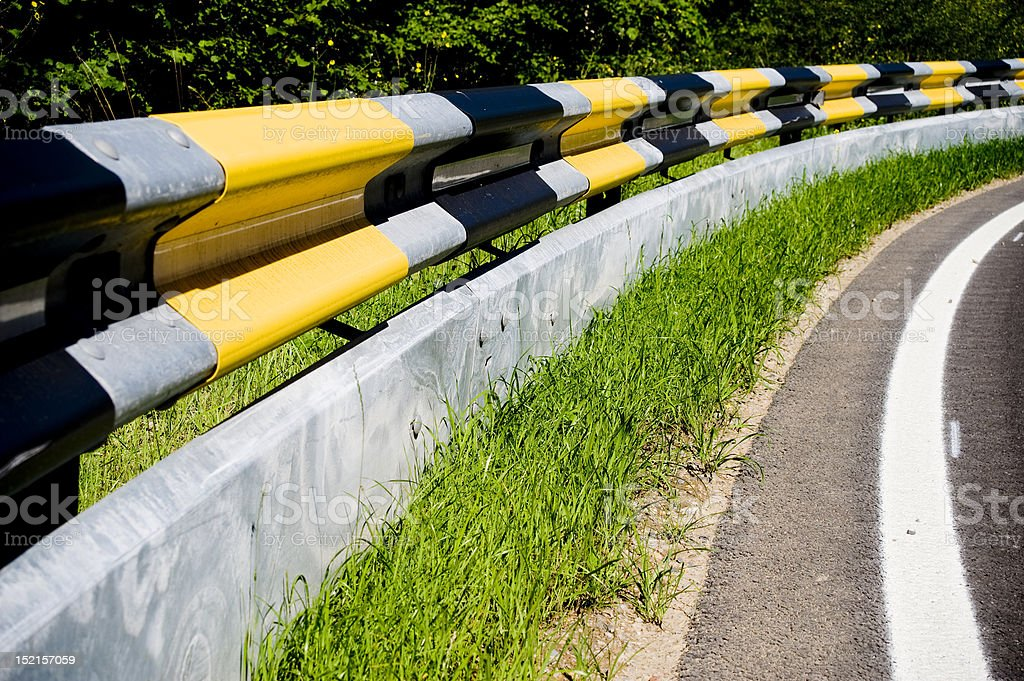 Guardrail with protection for motorcyclists stock photo