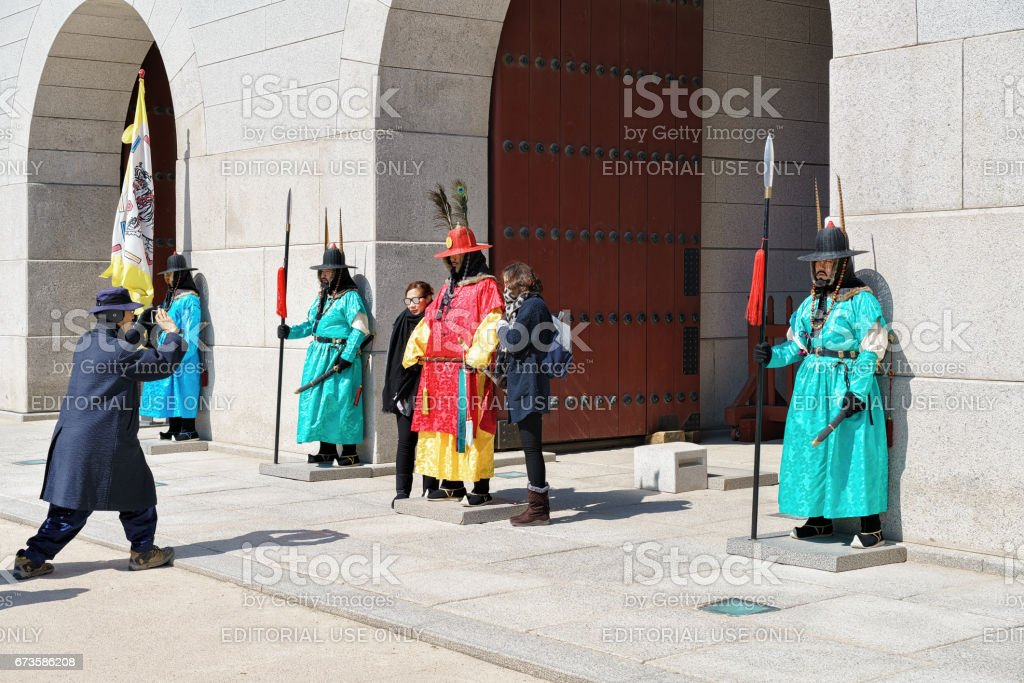 Guards after changing guard ceremony at Gyeongbokgung Palace of Seoul stock photo