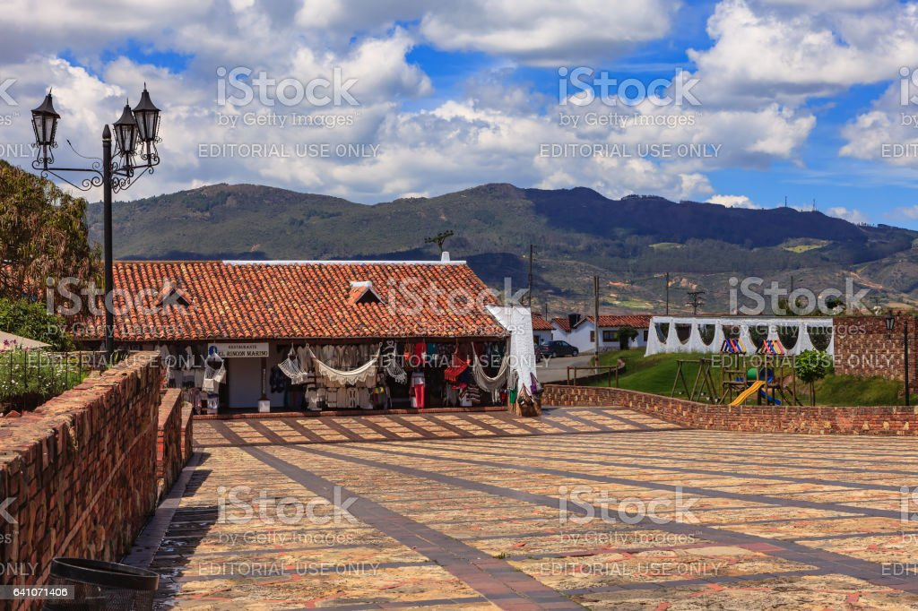 Guatavita, Colombia -  Handicraft Shops on the Town Square; the Andes Mountains in the Background. stock photo