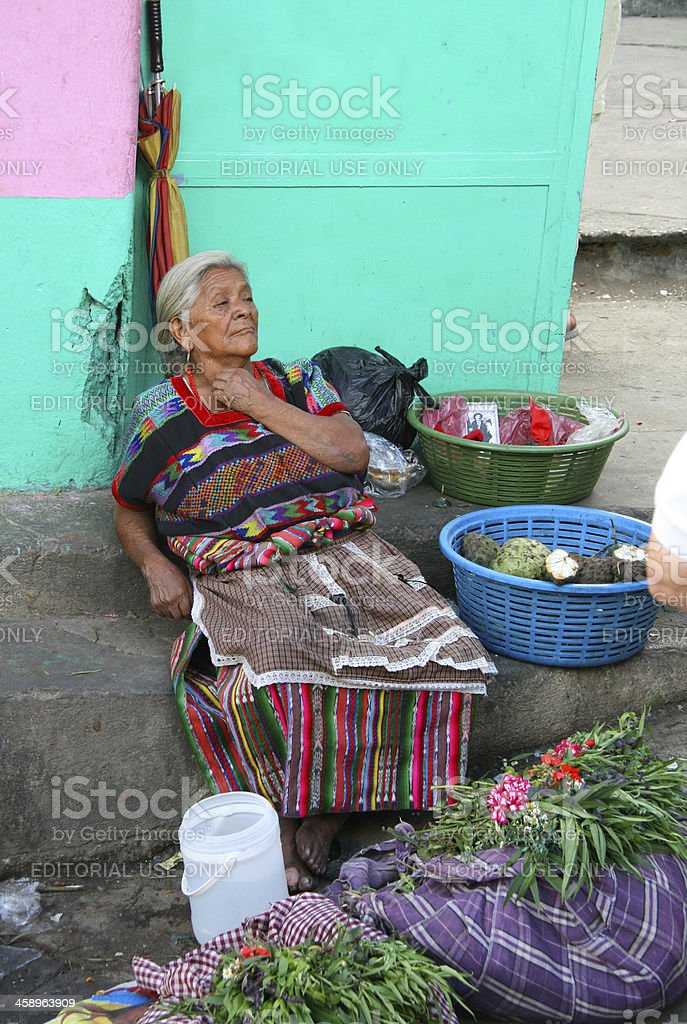 Guatemalan senior woman selling flowers and vegetables. royalty-free stock photo