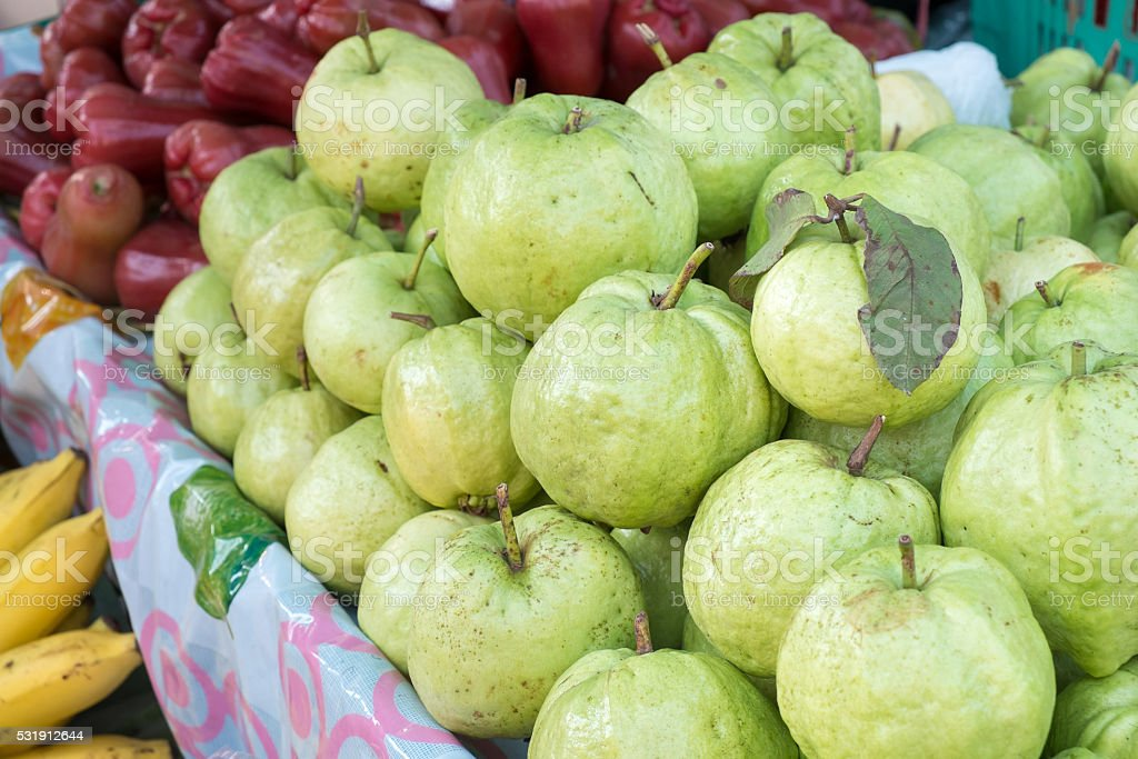 Guava and another fruits stand on the shelf stock photo