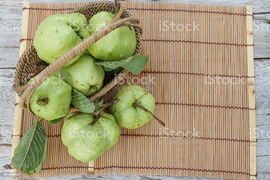 Guava fruit in the basket stock photo
