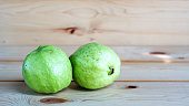 guava fruit on a wooden background, soft focus.