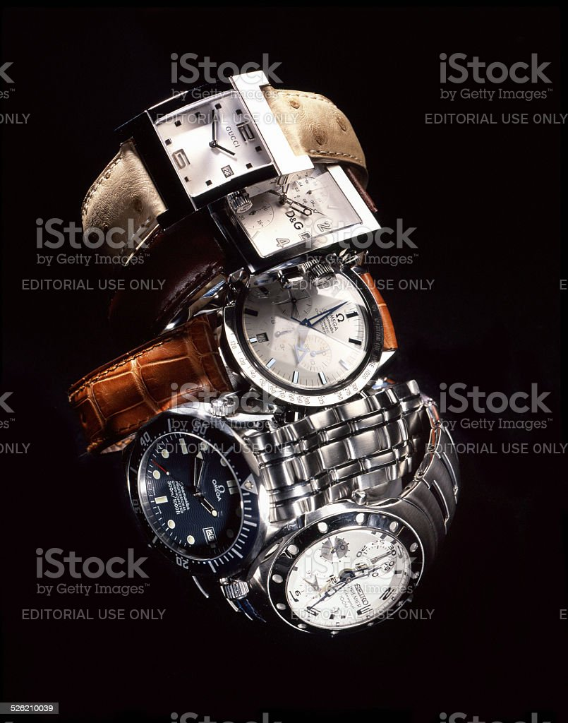 Gucci, Omega, Swatch, Seiko, Dolce & Gabbana luxury wristwatches stock photo