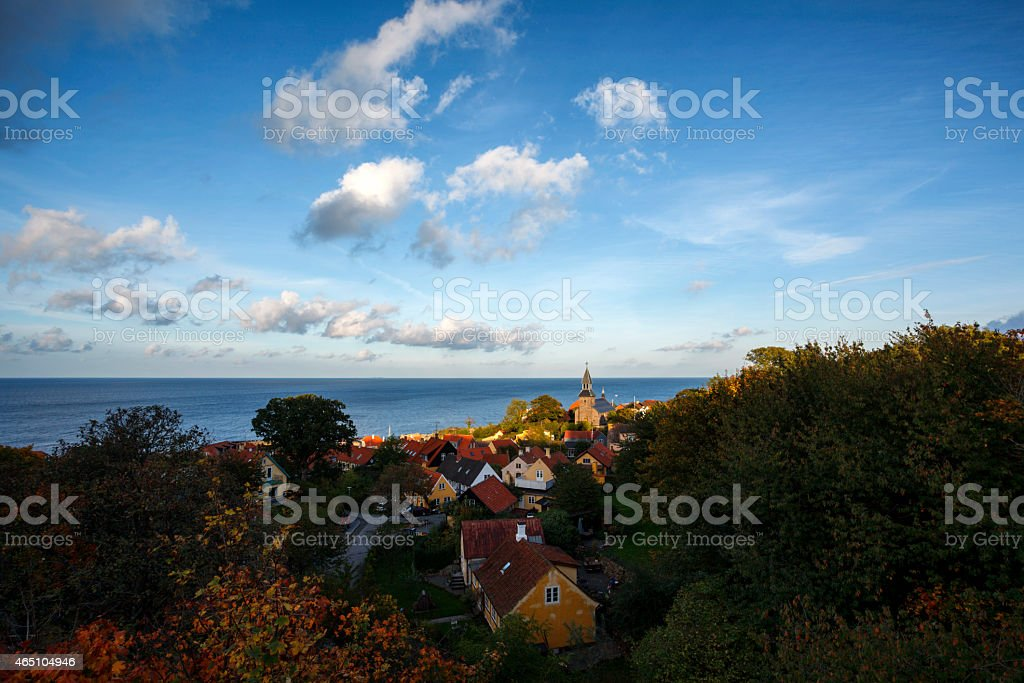 Gudhjem church at Bornholm lit by the autumn sun stock photo