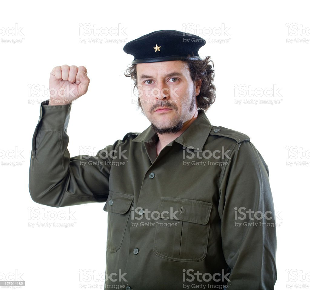 Guerilla raising fist stock photo
