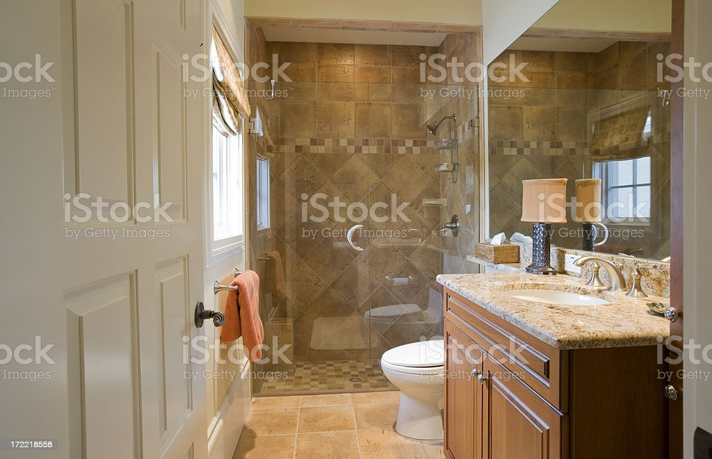 Beautiful guest bathroom with granite counter tops and marble floors...