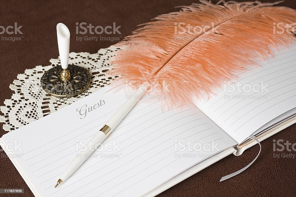 Guest Book and Pen on Doiley royalty-free stock photo