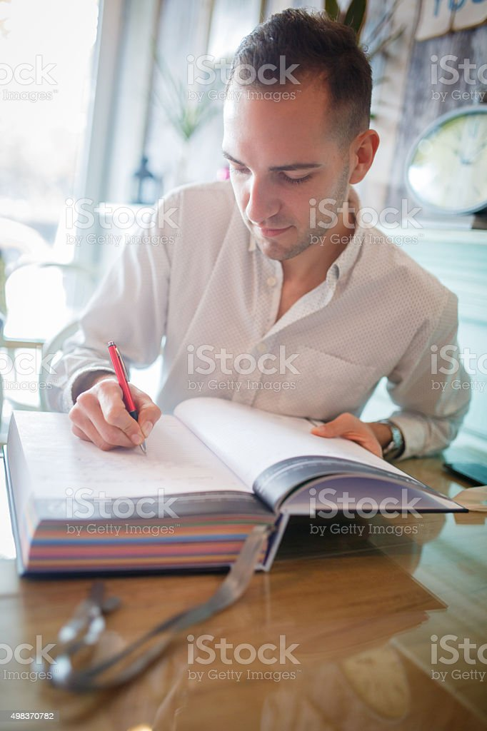 Guest book in a coffee shop stock photo