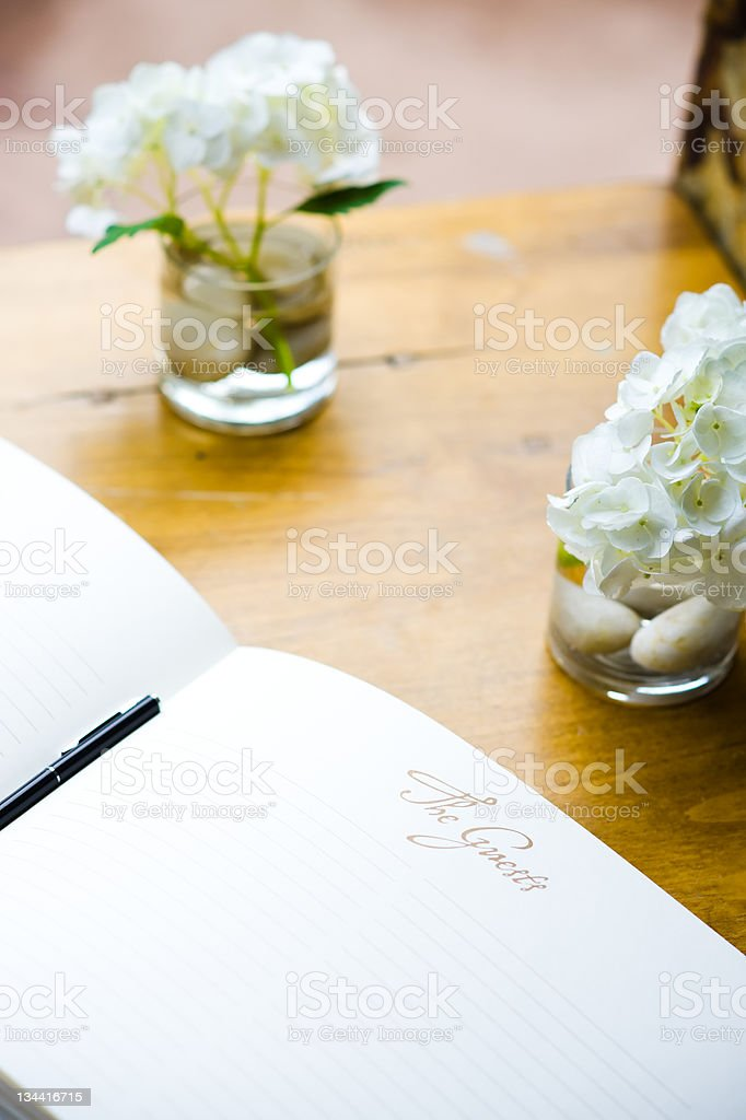 Guest Book on Wood Table to Sign at Wedding stock photo