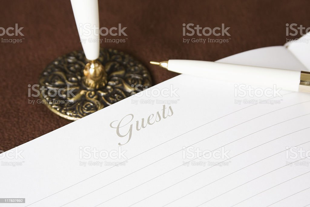 Guest Book with White Pen royalty-free stock photo