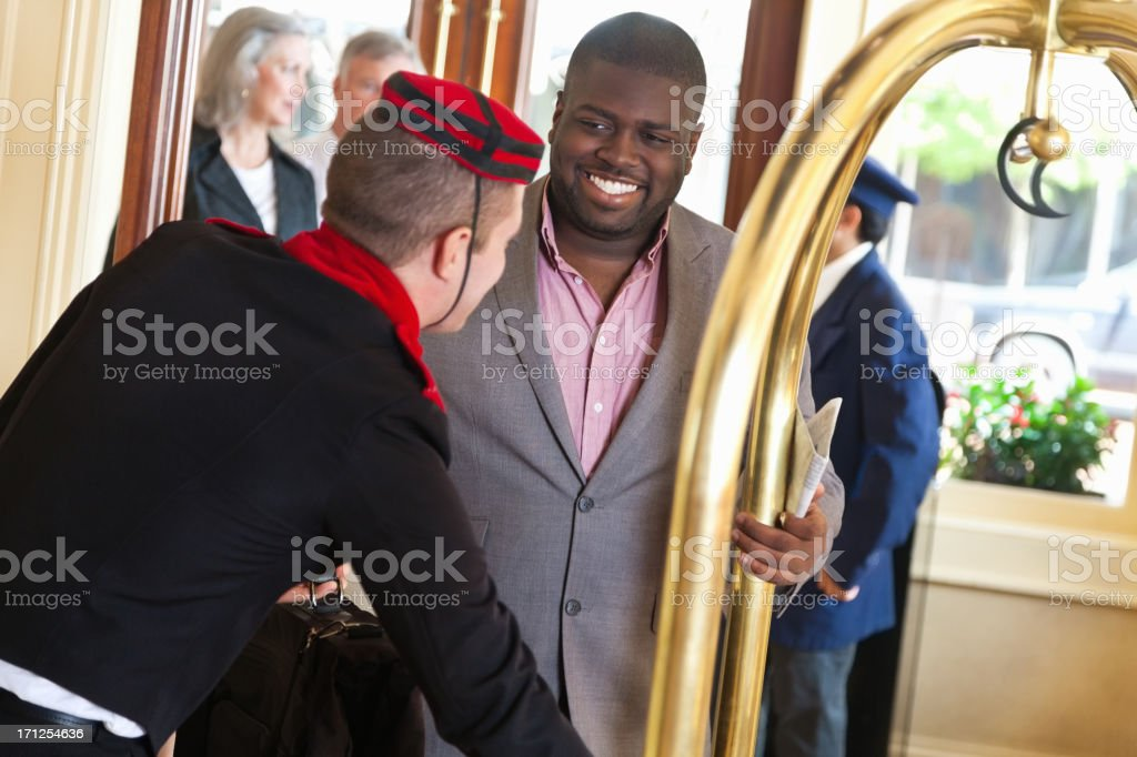 Guest receiving help from hotel bellhop stock photo