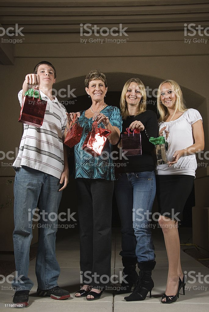 Guests in the driveway holding presents royalty-free stock photo