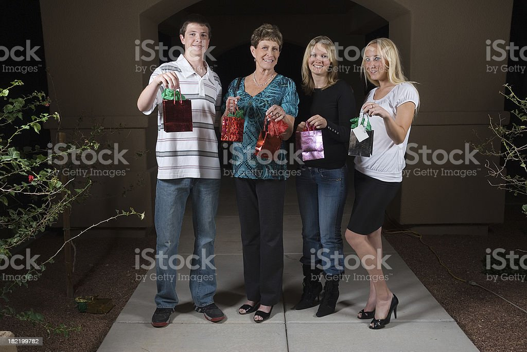 Guests in the driveway holding presents stock photo