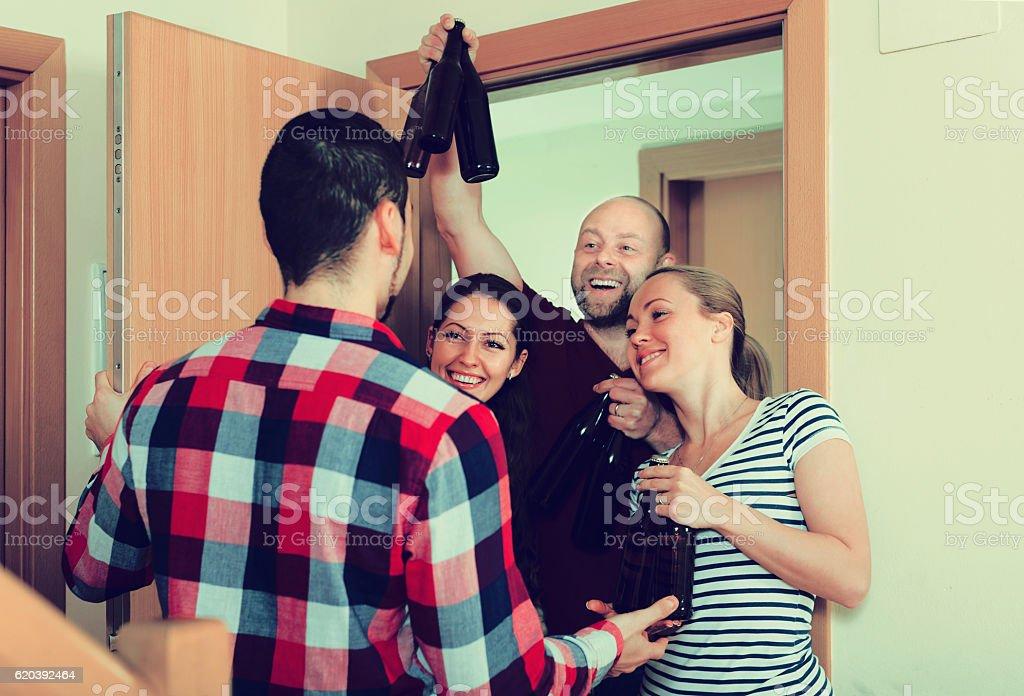 guests  standing in doorway stock photo
