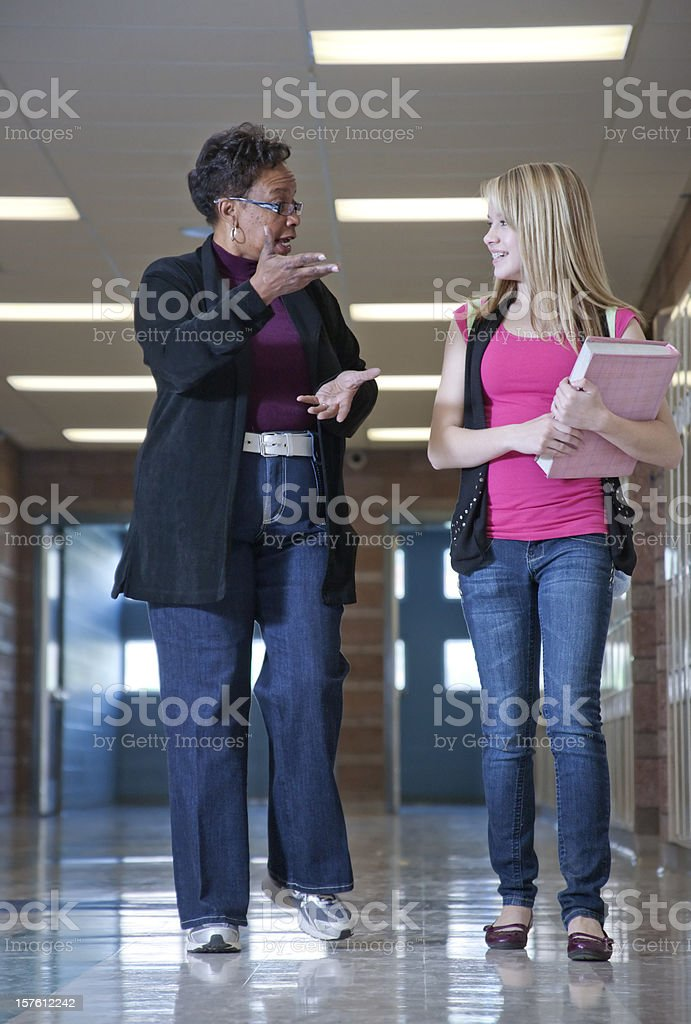 Guidance Counselor Walking with a Student royalty-free stock photo