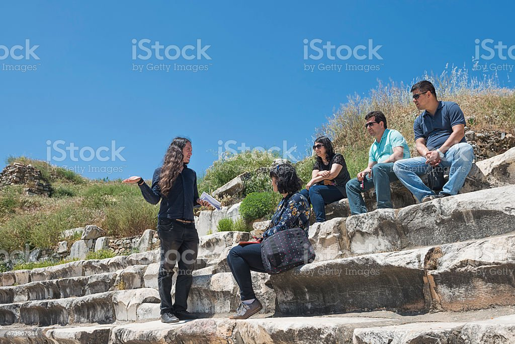 Guide and tourists in Aphrodisias stock photo